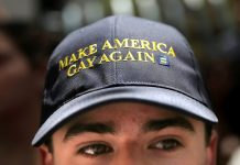 """A man wears a hat that says """"Make America Gay Again,"""" a parody of Donald Trump's campaign slogan while watching the San Francisco LGBT Pride Parade in San Francisco, California, U.S. June 26, 2016. REUTERS/Elijah Nouvelage"""